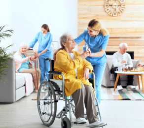 senior woman on wheelchair and caregiver looking at each other